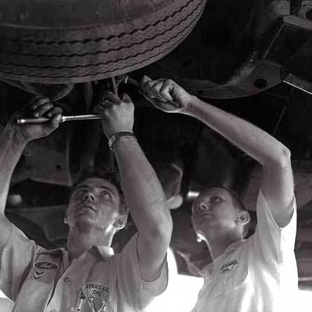 Picture of George Gates and Sid changing a tire